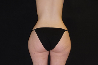 A person with heavy legs and a narrow waist