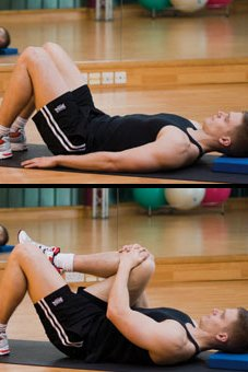 Picture of a man performing a knee to chest stretch