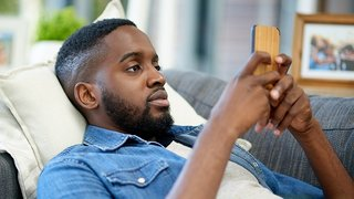 Man on the couch using his phone