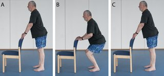 Picture of a man doing mini squats