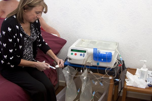 Picture of person having automated peritoneal dialysis (APD)