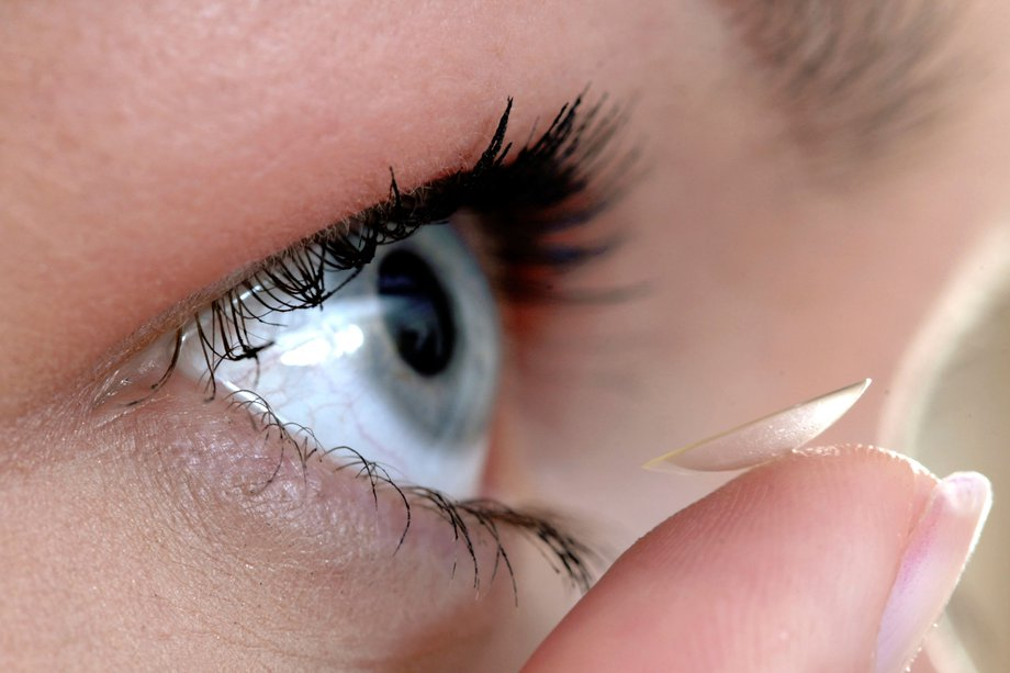 Close-up of a contact lens being put into an eye