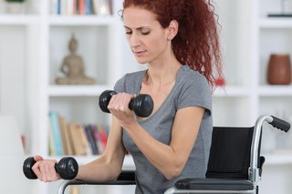 Using handweights while seated in a wheelchair