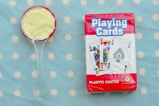 Just under 1 tablespoon of butter next to a pack of cards