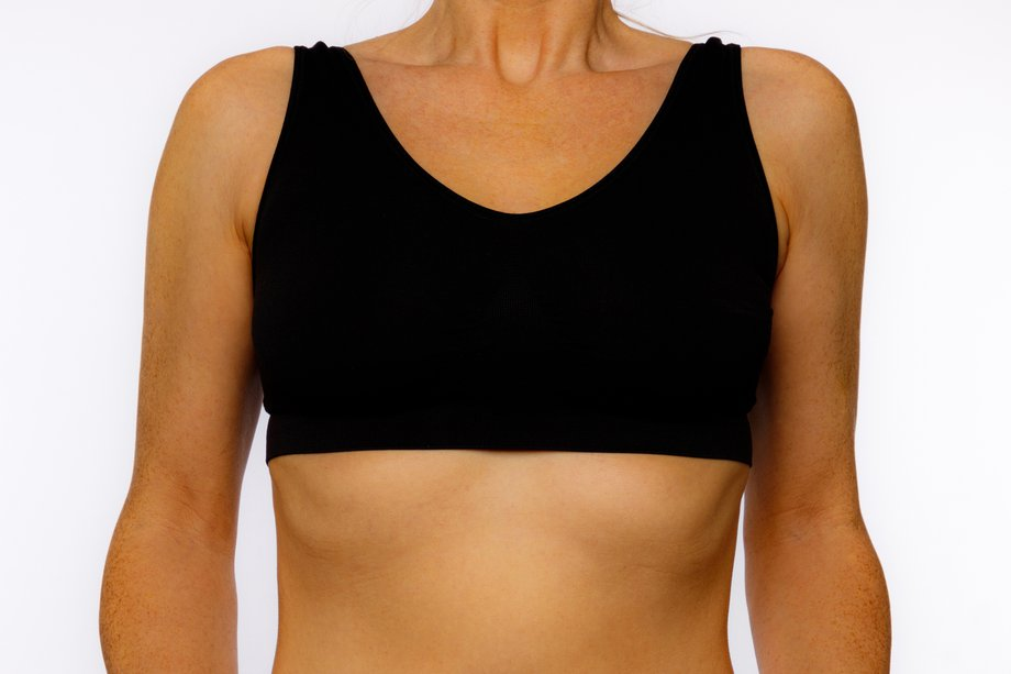 A woman wearing a correctly fitted sports bra