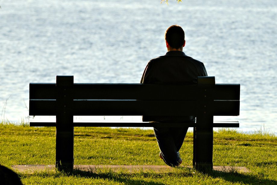 Picture of man sitting on a bench